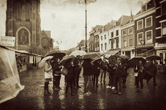 Tourists in the rain (glukorizon) Tags: 52weeksof2017 booth camera centrum collodianeffect collodioncamera collodiumcamera colourchange delft dirty fotoapparatuur fotocamera fototoestel groep grotemarkt group hss house huis kleurverandering kraam markt marktkraam monochrome monochroom nederland nieuwekerk paraplu photocamera rain regen sliderssunday stall stand umbrella vignettering vignetting vuil wetplatecollodioncamera zuidholland