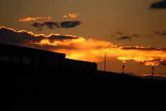 Sunset and Trains west of Cheyenne (kschmidt626) Tags: powder river coal colorado wyoming bnsf union pacific train glint sunset