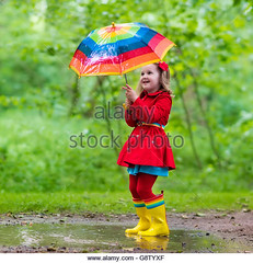 Child playing in the rain (hoangngaunguyen) Tags: rain umbrella kids child happy spring rainy autumn fun boots little girl weather water childhood people nature puddle day wet clothing coat colorful drops fall garden happiness jacket jump kindergarten outdoor outside park play pouring preschool preschooler raincoat season shower summer toddler waterproof wellies rainbow splash mud funny curly boy