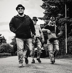 ZZ-top from Finland (funky shit happens) Tags: zztop people human bw road hämeenlinna band hats sunglasses beard walking tarmac group outdoor outside tree trees jeans summer tshirt