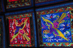 Fine Laotian Needlework. (john a d willis) Tags: laos luangprabang laotian nightmarket embroidery colourful cushioncovers