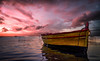 Lonely Boat (mcalma68) Tags: sicily marzamemi seascape sunset magenta boat