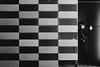 pointing and calling (tomorca) Tags: guard securityguard man check pattern monochrome blackandwhite street fujifilm xt2