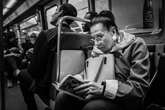 Reading in haste! (Mustafa Selcuk) Tags: booklovers bookreaders readers reading blackandwhite bnw bw siyahbeyaz monochromatic monochrome fujifilm xpro2 fujifilmfrance fujifilmfr street streetshooter streetphotographer streetphotography paris parisienne metro subway