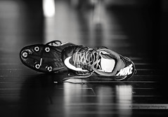 Cleats (Jenny Onsager) Tags: shoes cleats football messy nike teens sports reflection laces blackandwhite