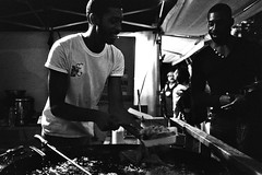 Enjoy (sam.naylor) Tags: london black white monochrome film 35mm pentax negative fomapan 400 street food people server culture evening moody takeaway eating chef cook meal