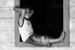 Sitting in the edge (Naturescrack) Tags: stateofamazonas brasil br window ventana life vida decision decisiones kid niño persona people retrato portrait nikkor nikon street streetphotography gente blackandwhite blancoynegro sit sentarse reflexionar reflect