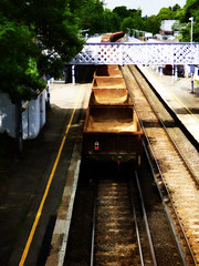 You Need to Paint Your Wagon (Steve Taylor (Photography)) Tags: wagon empty bridge mottinghamstation train station walkway railway track line green yellow white brown metal rust uk gb england yellowline greatbritain unitedkingdom london trees shadow sunny sunshine