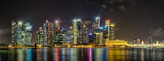 Singapore at Night (Anthony Kernich Photo) Tags: singapore asia city cityscape night nightscape marina bay lights view scene image photography olympus travel beautiful skyline world seasia downtown urban longexposure panorama edit colour color water yellow olympusem10 olympusomd singaporeriver asian metropolis skyscraper building architecture tallbuilding bayfront panoramic cityview citycenter citycentre stunning wow breathtaking magical flickr setting spectacular microfourthirds photo photogenic southeastasia lioncity dark nighttime outdoor