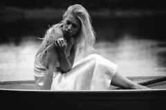 Loneliness (adbrucephotos) Tags: red blackandwhite woman boat lake lonely quiet silence whitedress dress portrait blonde hair blondehair yellowhair floating water shore paddles mystery mysterious mystique gaze lookingaway reflection reflections
