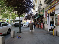 On the street (RubyGoes) Tags: madrid pavement people shop spain blue