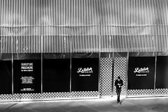 Pending the commencement (pascalcolin1) Tags: paris13 homme man ouverture commencement restaurant fermé closed lumière light noir black photoderue streetview urbanarte noiretblanc blackandwhite photopascalcolin 50mm canon téléphone phone portes doors