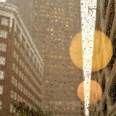 downtown downpour (jim_ATL) Tags: window rain raindrops dof yellow globe lamps reflection office building skyline abstract atlanta