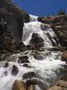 Tuolumne Falls (RobertCross1 (off and on)) Tags: 1250mmf3563mzuiko ca california em5 highsierra longexposure omd olympus sierranevada sierras tuolumne tuolumnefalls tuolumneriver yosemite yosemitenationalpark bluesky forest granite landscape rapids river trees water waterfall