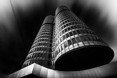 Darkstar (Robert_Franz) Tags: architecture architectural munich münchen urban city futuristic modern longexposure lookup building blackwhite blacksky dark abstract fineart