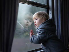 on the train (iwona_podlasinska) Tags: boy light window train journey travel godbye goodbye farewell nostalgic vintege