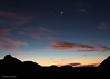 The Crescent Moon and Venus At Sunrise (Mimi Ditchie) Tags: venus moon mountains sunrise crescentmoon clouds pinkclouds silhouettes earthshine