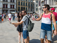 Snap 049 (Peter.Bartlett) Tags: bag tourists people streetphotography standing cellphone peterbartlett man girl candid couple mobilephone woman urbanarte urban lunaphoto ricohgr men venezia veneto italy it