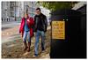 A Break Up..... (realjv) Tags: autumn breakup couple fujifilm london man millbank poster streetphotography walking woman x100 x100t