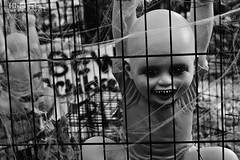 Playpen (Hi-Fi Fotos) Tags: halloween display decoration scary doll kid ghoul freak yard horror cage playpen campy evil haunted nikkor 40mm micro nikon d7200 dx hififotos hallewell mono bw blackandwhite fangs creepy
