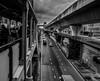 DSC_3994 (R-A-K-I-B) Tags: blackwhite streetphotography skytrain road street black white car vehical cloud people