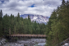 Bridge to the Past (writing with light 2422 (Not Pro)) Tags: longmire longmirecampground mountrainiernationalpark mountrainier volcano stratovolcano sonya77 richborder landscape washingtonstate bridge river nisquallyriver clouds