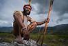 Dani Tribal Warrior (wu di 3) Tags: papua indonesia dani tribe warrior feather bow arrow darkcloud broodingsky mountainrange stoneage