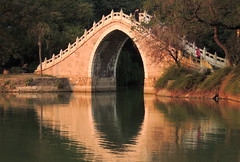 Beautiful Chinese bridge at garden - Hefei, China (German Vogel) Tags: asia eastasia china travel traveldestinations traveltourism tourism touristattraction landmark holidaydestination famousplace hefei anhuiprovince chineseculture traditional baohe lordbao moonbridge bridge chinesegarden chinesebridge pedestrianbridge garden publicpark goldenhour afternoonlight afternoon day serene peaceful
