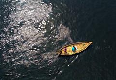 The ripple maker (Aranya Ehsan) Tags: lifestyle life people bangladesh dhaka minimalism travel boat boatman aranya river