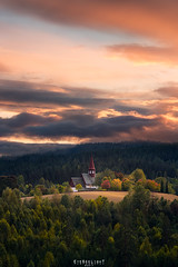 The Shining (Ron Jansen - EyeSeeLight Photography) Tags: hedenstad heistadmoen buskerud norway autumn sunset colors pittoresque church small tiny old light shine dramatic atmosphere color vertical d810 nikon
