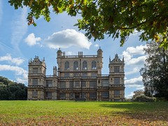 Wollaton Hall......... (klythawk) Tags: wollatonhall elizabethanmansion architecture autumn leaves sunlight bluesky clouds shadows green grey blue brown white olympus omd em1mkll 1240mm wollatonpark nottingham klythawk