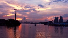 Harbour Sunset (elenaleong) Tags: harboursunset sentosa sundown seaside cranes elenaleong singapore cloudy architecture