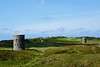 Two l'Ancresse loophole towers and the La Varde Dolmen between them - Guernsey, Channel Islands (Monceau) Tags: guernsey channelislands ancresse tower 18thcentury defense 46offthebeatentrack 117picturesin2017 landscape lancresse lavardedolmen golfcourse