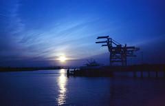 Sunset from Jack London square (-Alberto_) Tags: oakland cranes olympusxa2 kodakektar seascape bayarea 35mmfilm blue