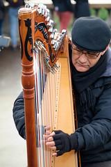 The Harp Player (BrianEden) Tags: harp france portrait montmartre 18emearrondissement musician streetmusician fujifilm 18th paris xpro1 streetphotography fuji candid player music harpist performer îledefrance fr