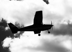 cloud pleaser... (Stu Bo) Tags: aircraft airplane airport lookup daydreaming sbimageworks sky clouds plane blackandwhite bw monotone flying