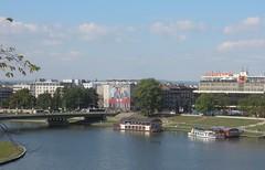 Poland (Krakow) Vistula River and modern parts of city (ustung) Tags: poland krakow vistula water park river bridge building boat tree city grass