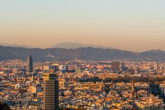 Barcelona cityscape at sunset overlook (altextravel) Tags: barcelona sunset spain catalonia city cityscape view urban evening overlook night travel architecture europe nobody tourism landmark building town sky landscape famous montjuic agbar tower