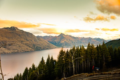 Sunset at the lake (amcatena) Tags: yellow sky lake red sunset travel blue clouds tree new zealand snow pine landscape outdoor