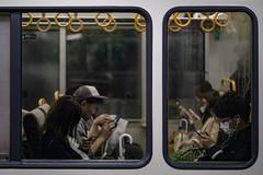 Mobile phones (karinavera) Tags: city night photography urban ilcea7m2 street japan tokyo people window mobilephones