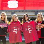 Students pose with Red and White Week T-shirts and signs