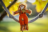 Swinging girl  - Anderson S.C. (DT's Photo Site - Anderson S.C.) Tags: canon 6d 135mmf2l lens upstate south carolina autumn fall foliage decoration bokeh depth field blur maple tree doll andersonsc america usa decor yellow plaid southernlife scenic rope swing leaves miniature