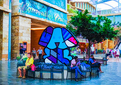 Resorts World Sentosa (Steve Taylor (Photography)) Tags: dog sitting resortsworld sentosa conventioncentre art digital architecture design shop store chair bench seat colourful men people woman ladies women singapore asia tree cartoon tile texture seated