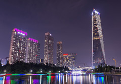 Sheraton and Oakwood Premier Incheon at night (Masoud Najari) Tags: incheon korea cityscape photography lake light trails city seoul architecture dusk night nighttime purple blue reflection passage yellow boat paddle bridge skyscraper building water tree tower tall
