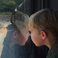 The train ride (Patricia McAtee - Photos of Maine) Tags: train dreams reflection trainride youth locomotive outdoor traintrack window believe summer perspective
