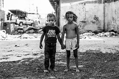 (Georgina ♡) Tags: people portrait monochrome blackandwhite streetphotography children boys athens greece road shoeless holdinghands friends cityscene graffitti barefoot shorthair longhair expressions jeans tshirt shorts barechest