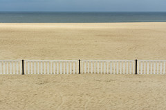 White fence on the beach (Jan van der Wolf) Tags: map172309v sand zand hek hekwerk sea zee seascape seaside beach strand fence symmetric symmetry symmetrie oostende