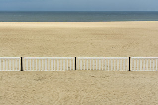White fence on the beach