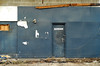 Indy#16385_Copy (Single-Tooth Productions) Tags: exteriorwall decay decaying abandoned abandonedbuilding door bluedoor doorway weathereddoor bleak restroom bathroom blue bluewall composition shapes lines colorblocks 2d flat architecture architecturaldecay architecturaldetail architecturalcomposition neglect forgotten e10thst indianapolis indiana urban city building buildingdetail buildingdecay urbandecay 50mm nikkor nikkor50mm nikond200 nikon