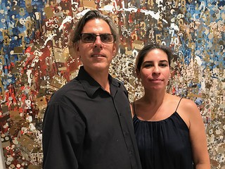 Artist John Bailly and wife Natalia with his artwork at the opening of LnS Gallery near Coconut Grove